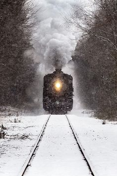 Essex Steam Train passing through Deep River, Connecticut during a snowstorm.