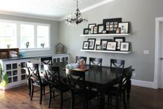 Love the gray wall color...and the ceiling!  Oh the ceiling!  Treated with tounge and groove planks.  Cute gallery wall with shelves.