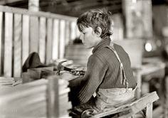 "A Basket Factory: October 1908. Evansville, Indiana. ""Boy making melon baskets. A Basket Factory."" Photograph by Lewis Wickes Hine"