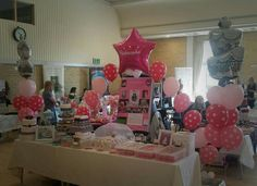 Pink polkadot balloon make this cake stand stand out! vipballoons.co.uk