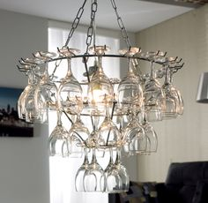 A unique yet practical chandelier which will be the talking point of any dining room. Consisting of 31 wine glasses each of which is removable allowing you to simply stretch up for a glass during dinner.