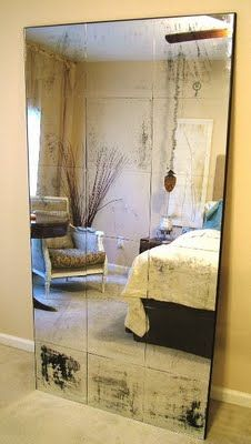 how to make a huge antiqued mirror...and fill the giant empty wall by my landing..yesss