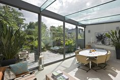 Trombé :: Contemporary Modern Conservatories and Conservatory Design London :: Structural Glazing Enclosed Decks, Enclosed Porches, Glass Extension, Extension Ideas, Modern Conservatory, Glass Room, House Deck, Room Additions, House Extensions