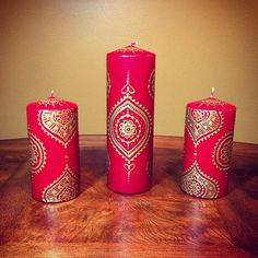 I love this! We could do a design like this on Glass with the stems inside? :D Henna Candle Set Red and Gold