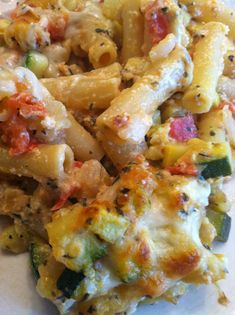 Baked Ziti & Summer Veggies Ѽ 4 oz uncooked ziti; 1 TBsp olive oil; 2c chopped yellow squash; 1c chopped zucchini; ½c chopped onion; 2c chopped tomato; 1-2 garlic cloves, minced; 1c (4 oz) shredded part-skim mozzarella cheese, divided, 2 TBsp chopped fresh basil; 2 tsp chopped fresh oregano; ¾ tsp salt, divided;  1/8 tsp crushed red pepper; ¼c (2 oz) part-skim ricotta cheese; 1 large egg, lightly beaten
