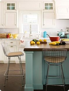 Maybe I should go all white for the kitchen. I love this pop of blue, yellow and red.