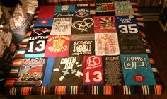 My 1st T-shirt quilt. The border is created from her favorite sweater. This was so so so much fun to make!!!