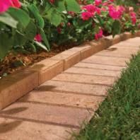 I saw this done in a garden tour...it looks and works great!  Easy mowing and NO trimmer needed!  The Best Garden Bed Edging Tips