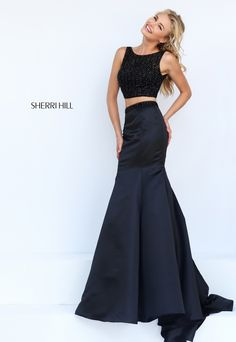 Spring 2016 # 50098 Black isn't always basic. Cropped bodice covered with jet black beads is teamed with a fit and flare skirt. Colors: black