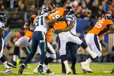Chris Clemons and Cliff Avril give Manning a hug.  Super Bowl XLVIII  #Seahawks