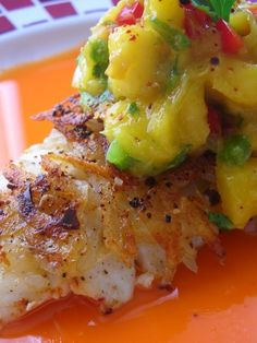 Potato and cascabel-crusted halibut with carrot-mango broth and mango salsa.