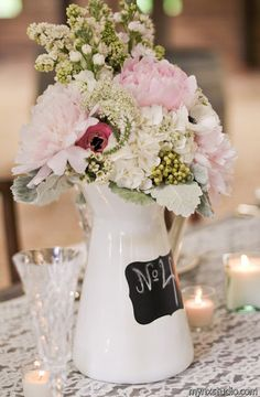 table number on flower vase centerpiece.