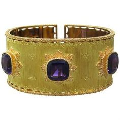 """Beautiful 18k gold cuff with 3 10.5mm x 10.3mm amethyst gemstones DESIGNER: Buccellati MATERIAL: 18K Gold GEMSTONE: Amethyst DIMENSIONS: Bracelet will fit up to 6"""" wrist and is 28mm WEIGHT: 61.2g MARKED/TESTED: Buccellati,750 CONDITION: Estate PRODUCT ID: 12593"""