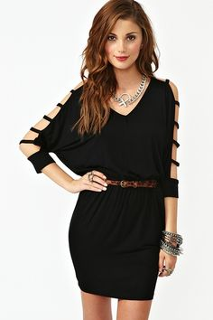 Draped black jersey dress featuring strapped dolman sleeves and cutout back. Front pockets, stretch panel at waist. Looks rad worn belted with platform boots!