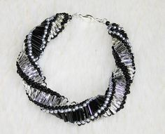 Black and silver spiral bracelet of tube beads by enlora on Etsy