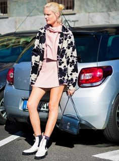 Hanne Gaby Odiele wears a pastel matching set, black and white jacket, rugged boots, and a flap bag