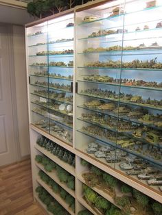 Glass cabinets for miniature figures. This looks tidy, and is a great dust-proof way of displaying a collection, with easy access for use as well. Kudos to whomever this game room belongs to! They've definitely created a space perfect for their gaming.