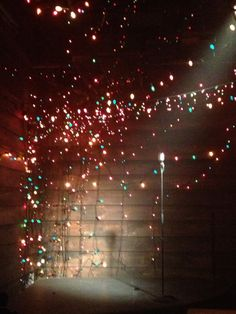 scattered strung lights - maybe on the upper balcony