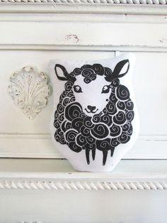 Plush Lamb or Black Sheep Pillow. Hand Woodblock Printed. Customizable Colors. Made to Order.. $16.50, via Etsy.