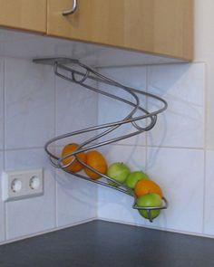 Fruit slide: Better then a bowl sitting on the counter. #fruit #kitchenspaces #fruitbasket #fruitbowl