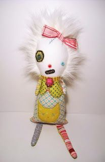 I really like this one. She's more sweet than scary. I would maybe just put something else on her dress.... Deathly allergic to cats here...