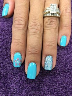 Flower and glitter nails. Gel polish