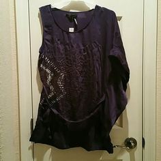 SALE!!! Purple One Shoulder Batwing Shirt Reg $30 NWT. Beautiful purple half sleeveless half batwing shirt that ties around the waist.  Extremely cute.  Perfect for a night out paired with leggings, jeans or a skirt and boots.  100% Polyester. (Juniors) Marineblu Tops