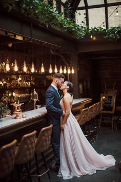 This Halifax wedding inspiration is the epitome of style with swanky bars, princess gowns, and florals galore → http://junebugweddings.com/wedding-blog/downtown-bar-wedding-inspiration-at-lot-six-in-halifax/  Image by J Wells Photography | Event Planning by Make Merry Events | Floral design by Twig & Twine Floristry | Cake by Just Iced Custom Cakes | Makeup by Selena Marchand Makeup Artistry | Hair by Zipora Hunter Hair & Makeup | Dress by Katrina Tuttle Bridal | Jewelry by Sarah Sears…