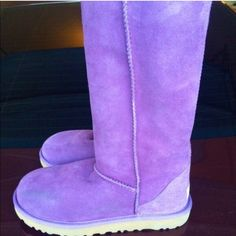 New! Ugg boots UGG Australia's Classic Tall features cuffable Twinface sheepskin in a palette of seasonal shades. Women's size7! (Fits up to a 7.5/8). Color Anemone (Light purple)   New (without box)! Price listed is negotiable. Only serious offers please and no trades. Can post additional pictures upon request. UGG Shoes Winter & Rain Boots