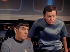 Whoever they're looking at, said something really good ... you know it's good because Spock is almost-smiling and Bones is scowling.