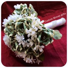 Money Rose Bouquet. Made for a previous client.This bouquet will catch everyone's attention and will sure be the Bride's favorite gift on her wedding or engagement. Available upon request with any denomination of money. For price and ordering please text, message or call Margarita @ 818-903-2202.