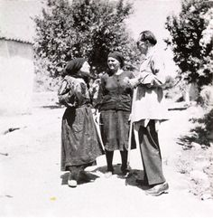 Nikos Kazantzakis, member of the Central Committee for the Verification of Atrocities on Crete, at the Fournes Village (Crete), receiving information from village women. July 1945. The mother of Katina Leventaki narrates how her daughter disarmed the German soldier.