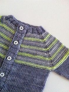Lancashire Dream Knitted with fingering yarn, this unisex top-down cardigan has a nice vintage look.