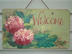 Love the colors in this hand painted slate welcome sign. via Etsy.