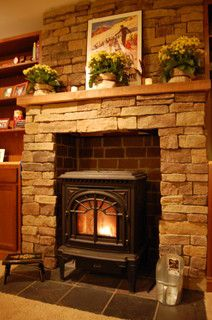 Good Looking pellet stoves for sale in Home Theater Traditional with Stone Hearth next to Pellet Stoves alongside Pellet Stove Fireplace Mantels and Faux Stone Fireplace - Houses interior designs Wood Stove Surround, Wood Stove Hearth, Stove Fireplace, Fireplace Design, Fireplace Mantels, Fireplace Modern, Mantles, Fireplace Glass, Faux Fireplace