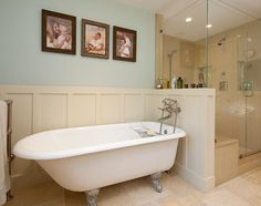 clawfoot tub, white wainscoting