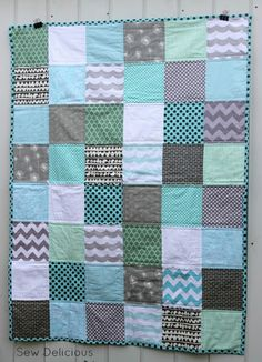 Last month I made two quilts for my cousin's fundraiser to raise money for Ovarian Cancer Research. The first quilt I made was this one. I chose an aqua, teal and grey colour scheme as they are the colours that represent Ovarian Cancer Awareness. I have Sandy from Wrapped In Fabric to thank for collaborating…