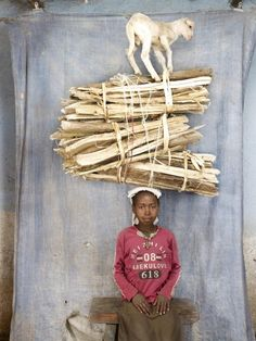 "Floriane de Lasse from the series ""How much can you carry?"", @Aru, Ethiopia"