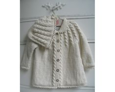 "Child Knitting Patterns Zia & Tia Natural Hand knit Cable Matinee Sweater - Women the sample is free on ""Drops"" Baby Knitting Patterns Knitting For Kids, Baby Knitting Patterns, Baby Patterns, Hand Knitting, Baby Sweaters, Girls Sweaters, Knitted Baby Clothes, Knit Or Crochet, Vintage Knitting"