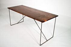 Knotty walnut  desk with hand forged steel base. $500.00, via Etsy.