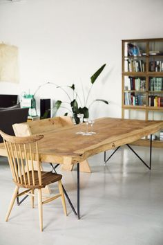 Dining table is a redwood slab they bought at a place called Burlwood in Berkeley, legs made on Etsy.