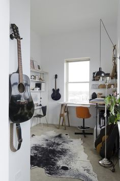 """Sneak Peek: A Modern Chicago Home. """"We turned the second bedroom into a studio space since we are both designers. The cowhide is from Ebay."""" #sneakpeek"""
