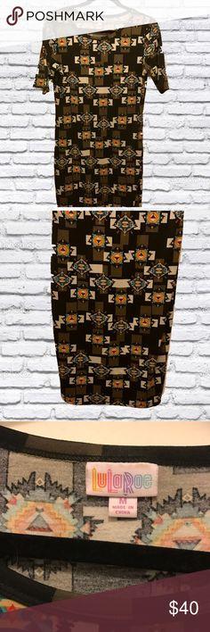 SALE ❤️LulaRoe Julia Dress Aztec Tribal Print Good condition Julia - she's so versatile! I loved pairing this print with a black leather jacket or with a LLR skirt. Description:  The Julia dress is a form fitting, knee- length, knit dress with mid-length sleeves and a high neckline. Its simple silhouette makes the Julia dress a great canvas for layering and accessorizing. This dress is a staple for every season's wardrobe. It is feminine, flattering, and you may not ever want to take it off…