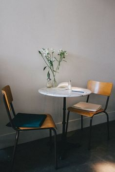 : A marble-topped cafe table and vintage chairs that likely came from a school. For a modern version of the seats, see Belgian company Zangra's stackable School Chairs.
