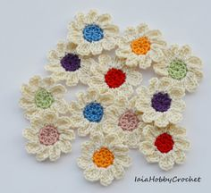 12 Crochet Flowers Appliques, embellishments .  Made from a lovely soft 100% cotton crochet thread .  Each flower is approximately 3.5 cm in diameter (11/4).  Great embellishments for your scrapbooking and sewing projects: just sew them on hair bands, hats, bags, gift tags, clothe, pillow, doll dress or glue them to scrapbook pages, greeting cards, place settings.  Need them in different colours? See my others listing…