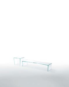 """TRIM design Victor Carrasco   Low tables with irregular shapes and special faceted grindings of the glass. Available in transparent extralight glass or in mm. 10 thick """"black paste crystal""""."""