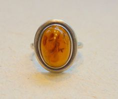 Oxidized sterling silver amber stone ring. $35.00, via Etsy.