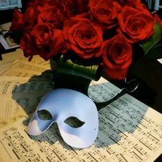 Our Phantom of the Opera theme tables incorporated the iconic mask, handheld mirrors and antique music sheets from Love Dove Trading Company. Gorgeous red rose arrangements created by Ariston Flowers (NY)