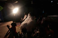 Pakistani groom, Phaloos Sohtra, and his bride Shabana Gill pray during their wedding in a church in a Christian neighborhood in Islamabad, Pakistan, on Oct. 5. (Muhammed Muheisen/Associated Press)
