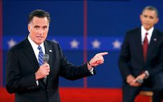 148 10/16/12 - Republican presidential nominee Mitt Romney, left, answers a question in front of President Barack Obama during the second U.S. presidential debate in Hempstead, N.Y., on Oct. 16, 2012. (REUTERS/Mike Segar)